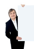 Female executive holding blank whiteboard Stock Photo