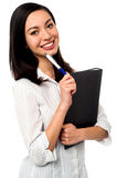 Female executive holding business file and pen Stock Photos