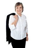 Female executive holding coat over her shoulders Royalty Free Stock Photo
