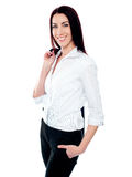 Female executive holding coat over her shoulders Stock Image