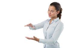 Female executive holding invisible object Stock Photo