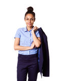 Female executive holding jacket over her shoulders Royalty Free Stock Photo