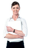 Female executive holding laptop tightly Stock Photography