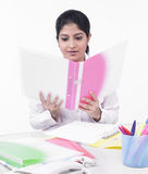 Female executive looking at a file Stock Image