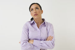 Female Executive Looking Up While Thinking Royalty Free Stock Image
