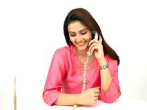Female executive on the phone. Young asian indian origin female executive on the phone royalty free stock photo