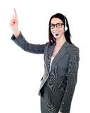 Female executive pointing up at copyspace Stock Images