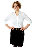 Female executive posing with hands on her waist Royalty Free Stock Photos