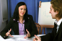 Female executive presenting a concept Royalty Free Stock Images