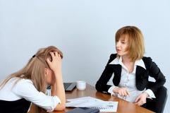 Female executive rebukes secretary Royalty Free Stock Photos
