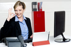 Female executive showing excellent gesture Stock Image