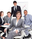 Female executive sitting in front of her team Royalty Free Stock Photography