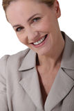 Female executive smiling Stock Images