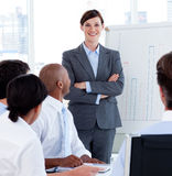 Female executive smiling at the camera Stock Images