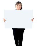 Female executive standing with a blank billboard Stock Photography