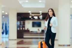 Elegant Business Woman with Travel Trolley Luggage in Hotel Lobby. Female executive with suitcase in work related business trip Stock Photography