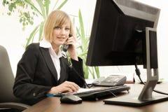 Female executive talking on phone Stock Photo