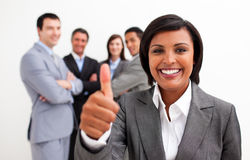 Female executive with thumb up Royalty Free Stock Images