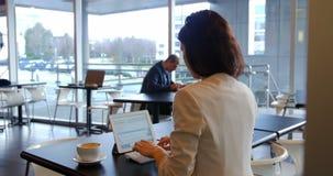 Female executive using digital tablet stock video