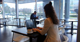 Female executive using digital tablet stock footage