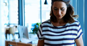 Female executive using digital tablet in office stock video footage