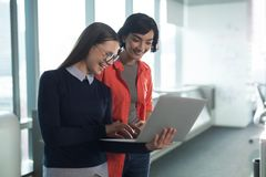 Female executive using laptop in office Royalty Free Stock Photos