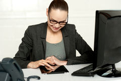 Female executive using tablet pc stock photo