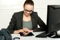 Female executive using tablet pc Stock Photo