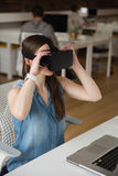 Female executive using virtual reality headset Royalty Free Stock Photos