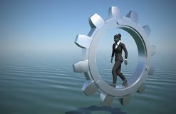 Female executive walking inside a gear at sea. A female executive walking on a gear at sea demonstrates her talent and effectiveness Stock Photos