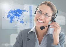 Female executive wearing headset against digital generated background Royalty Free Stock Image