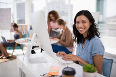 Female executive working on computer at desk in the office Stock Photo