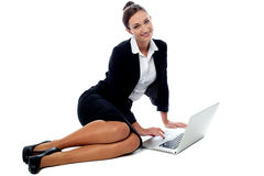 Female executive working in laptop. Stock Images