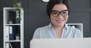 Female executive working at office. Female executive working on laptop at office stock video footage