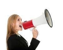 Female executive yelling through a megaphone. Isolated on white background Royalty Free Stock Image