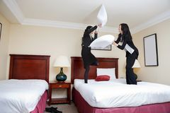 Female Executives Playing Pillow Fight Stock Photos