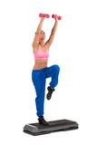 Female Exercise On Aerobic Step With Hand Weights Stock Photos