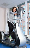 Female during exercise on a elliptical trainer Royalty Free Stock Photo
