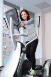 Female during exercise on a elliptical traner Stock Photography