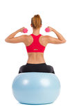 Female Exercise On Fitness Ball With Dumbbells Stock Images