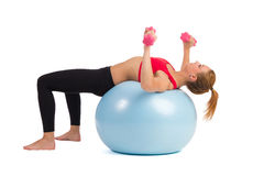 Female Exercise On Fitness Ball With Hand Weights Royalty Free Stock Photos