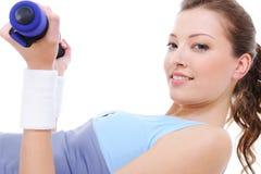 Female  exercises with dumbbells Stock Photo