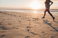 Female exercising on the beach Stock Photography