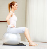Female exercising on a fitness ball Stock Image