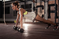 Female exercising at gym. Stock Photos