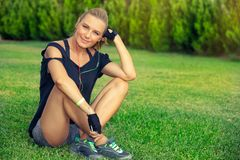 Female exercising outdoors royalty free stock photography