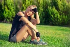 Female exercising outdoors stock photos
