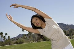 Female Exercising In Park Royalty Free Stock Images