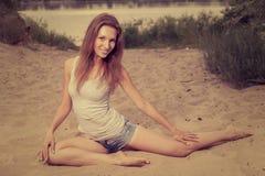 Female exercising on a sand Royalty Free Stock Image