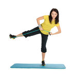 Female with expander in stretching fitness exercise Stock Photo